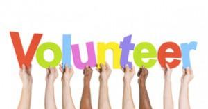 diverse-hands-holding-word-volunteer-41013777