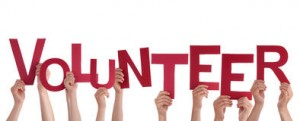 hands-holding-volunteer-many-red-letters-isolated-37470719